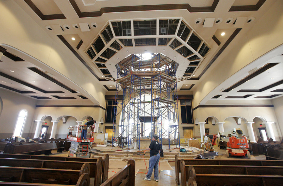 Photo - Crew members work inside the new sanctuary at St. Eugene Catholic Church, 2400 W Hefner Road in The Village.  PAUL B. SOUTHERLAND - PAUL B. SOUTHERLAND
