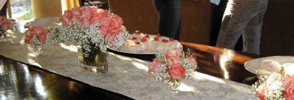 MEET ROSE....Pink roses and baby's breath decorated the table. (Photo by Helen Ford Wallace).