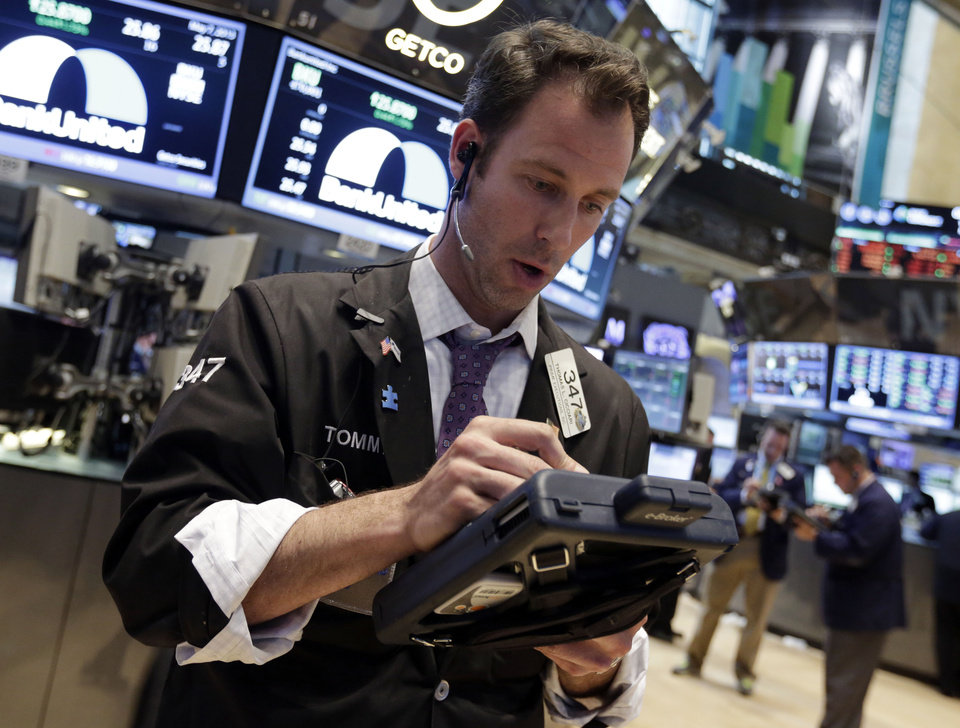 Photo - Trader Thomas Cicciari works on the floor of the New York Stock Exchange Tuesday, May 7, 2013. The Dow Jones industrial average punched through another milestone Tuesday: its first close above 15,000. (AP Photo/Richard Drew)