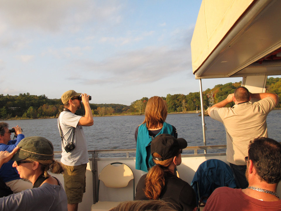 Photo - In this October 5, 2013 photo, birders and tourist bird watch aboard the boat