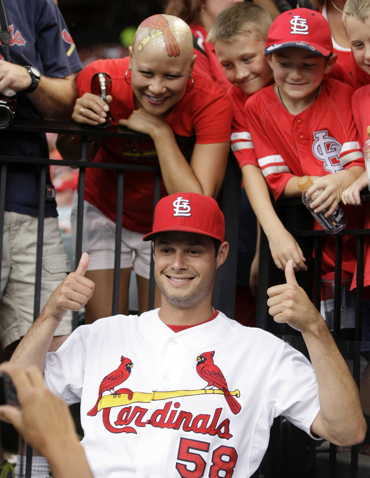 Photo - St. Louis Cardinals starting pitcher Joe Kelly poses with fan Moya Brown, upper left, during a rain delay at a baseball game between the Cardinals and the Philadelphia Phillies, Friday, June 20, 2014, in St. Louis. (AP Photo/Tom Gannam)