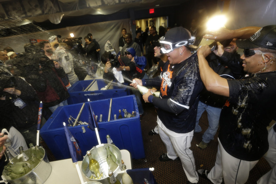 Photo -   Detroit Tigers' Miguel Cabrera, left, and Detroit Tigers' Octavio Dotel, right celebrate in the locker room after their team won Game 4 of the American League championship series 8-1, against the New York Yankees, Thursday, Oct. 18, 2012, in Detroit. The Tigers move on to the World Series. (AP Photo/Paul Sancya )