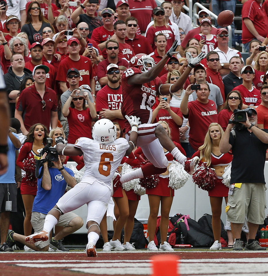 Photo - OU's Justin Brown (19) catches a touchdown pass beside UT's Quandre Diggs (6) during the Red River Rivalry college football game between the University of Oklahoma (OU) and the University of Texas (UT) at the Cotton Bowl in Dallas, Saturday, Oct. 13, 2012. Oklahoma won 63-21. Photo by Bryan Terry, The Oklahoman