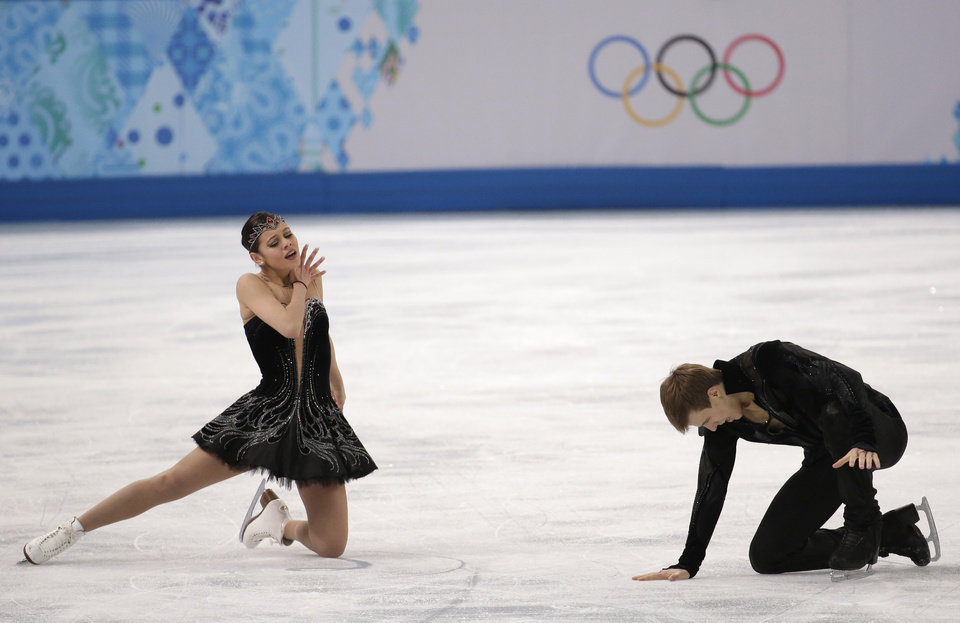 Photo - Elena Ilinykh and Nikita Katsalapov of Russia react after completing their routine in the ice dance free dance figure skating finals at the Iceberg Skating Palace during the 2014 Winter Olympics, Monday, Feb. 17, 2014, in Sochi, Russia. (AP Photo/Bernat Armangue)