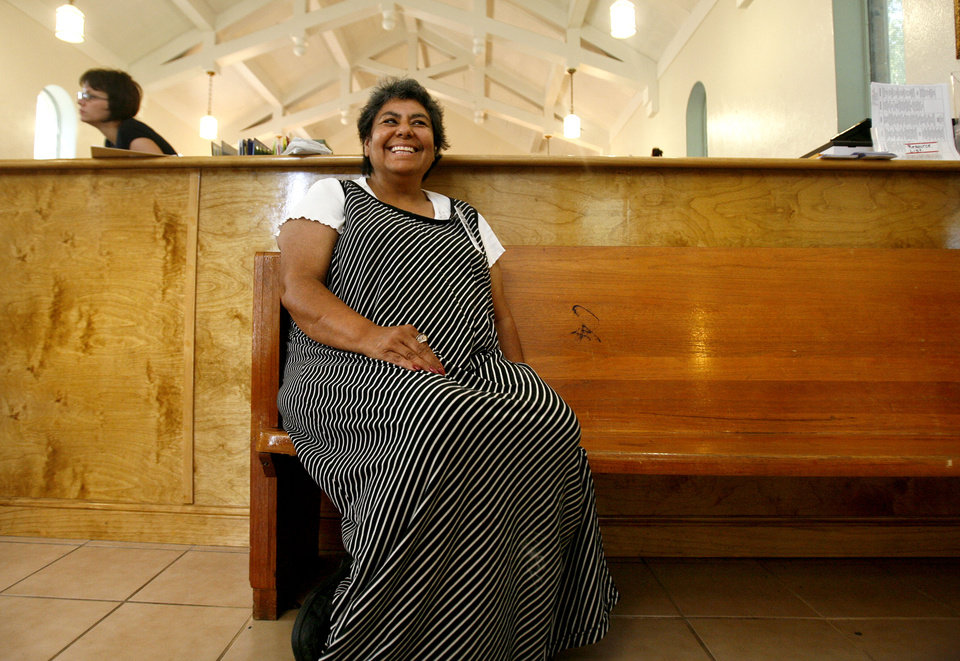 Photo - WOMEN'S SHELTER: Josie Wakley, 58, sits in an old pew of the old church that is now the Sanctuary Women's Development Center. Wakley, who is a volunteer, was once a woman who utilized the facility. She is a veteran with a social work degree, but because of disabilities that occurred after the war she was unable to find work with her degree.