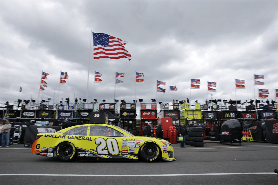 Photo - NASCAR Sprint Cup Series driver Matt Kenseth drives in the garage area at Pocono Raceway before practice for Sunday's NASCAR Sprint Cup Series auto race in Long Pond, Pa., Friday, June 6, 2014. (AP Photo/Mel Evans)