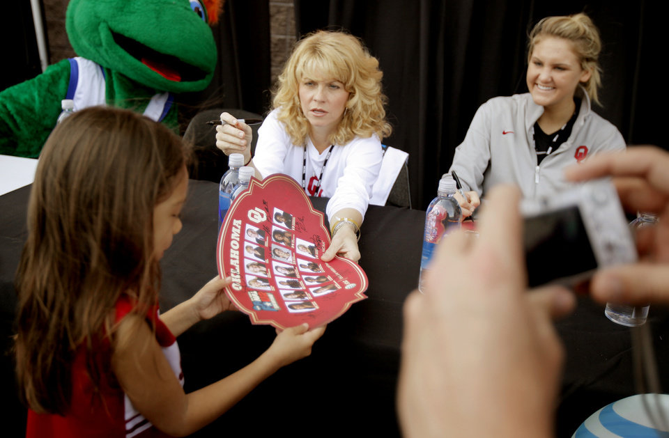 OU coach Sherri Coale hands an autographed poster to a fan before practice for the Final Four of the NCAA women's  basketball tournament at the Alamodome in San Antonio, Texas., on Saturday, April 3, 2010.  The University of Oklahoma will play Stanford on Sunday, April 4, 2010.