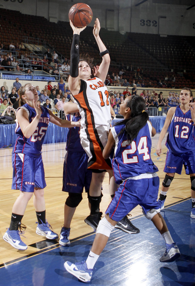Photo - Calumet's Mariah Miles shoots over Ft. Cobb-Brozton's Jennifer Johnson during the girls Class A high school playoff game between Calumet and Ft. Cobb-Broxton, Thursday, March 4, 2010, at the State Fair Arena in Oklahoma City. Photo by Sarah Phipps, The Oklahoman