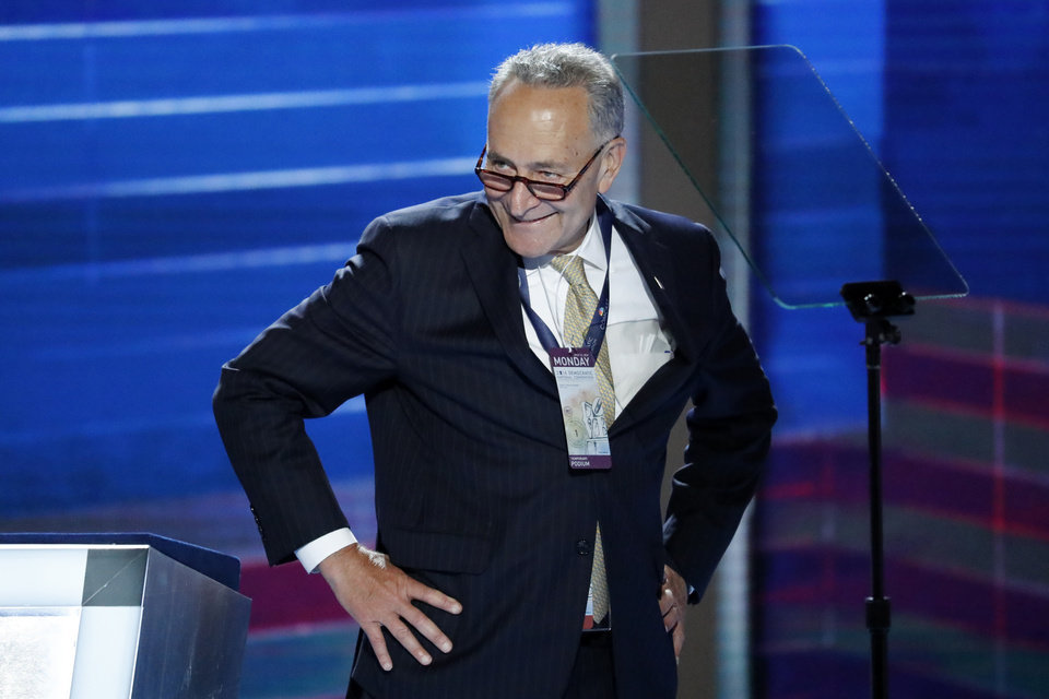 Photo - Sen. Chuck Schumer, D-NY., looks around the stage before the kickoff of the Democratic National Convention in Philadelphia , Monday, July 25, 2016. (AP Photo/J. Scott Applewhite)