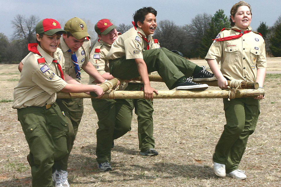 Barry Heath, John Jones, Patrick Dewitt, David Haggy (hidden), Cory Duran and Phillip Haggy race with an A-frame that they built during the annual Big Tepee District of the Boy Scouts of America Camporee at Choctaw Creek Park. Imaged Apr 1, 2006. Community Photo By: mark d. doiron Submitted By: Mark, Midwest City