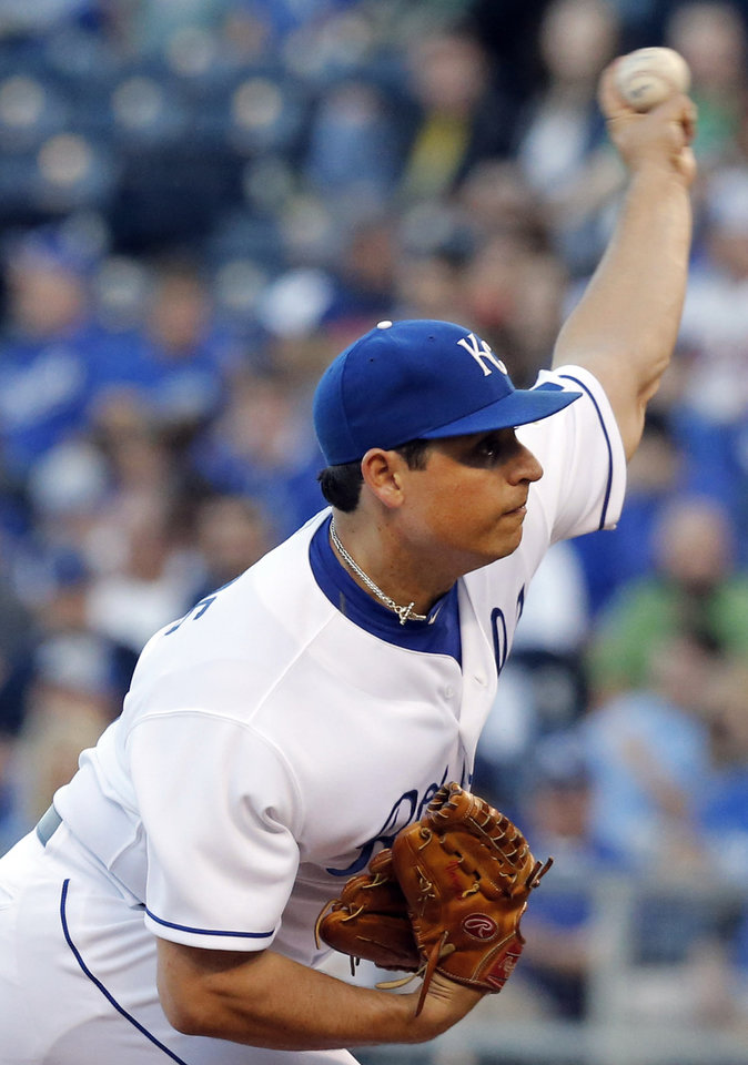 Photo - Kansas City Royals starting pitcher Jason Vargas delivers to a Minnesota Twins batter during the first inning of a baseball game at Kauffman Stadium in Kansas City, Mo., Friday, April 18, 2014. (AP Photo/Orlin Wagner)