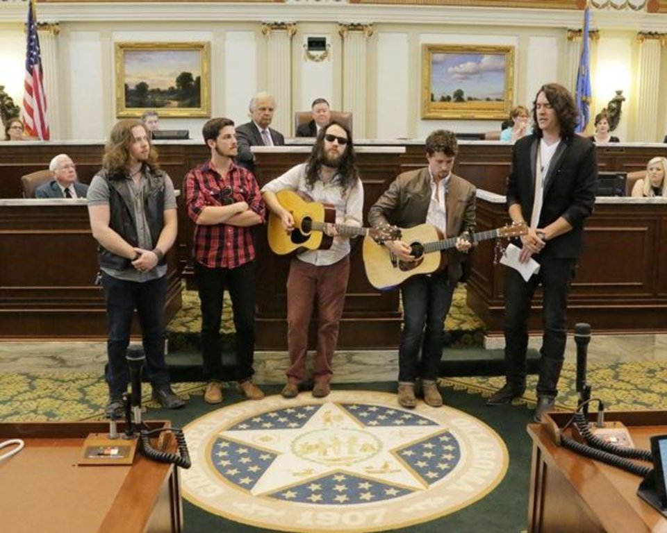 """Photo - The members of Oklahoma City-based country band Lower 40 -- from left, Sherman Haynes,  Michael Hines, Nick Work, Zach Felts and Kyle Earhart -- perform their song """"This Ole Place"""" on the floor of the state House of Representatives May 7, which was declared Lower 40 Day at the state Capitol. Photo provided"""