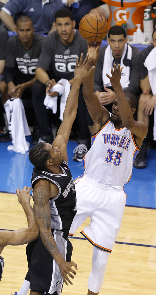 Photo - Oklahoma City's Kevin Durant (35) shoots over San Antonio's Kawhi Leonard (2) during Game 4 of the Western Conference Finals in the NBA playoffs between the Oklahoma City Thunder and the San Antonio Spurs at Chesapeake Energy Arena in Oklahoma City, Tuesday, May 27, 2014. Photo by Bryan Terry, The Oklahoman