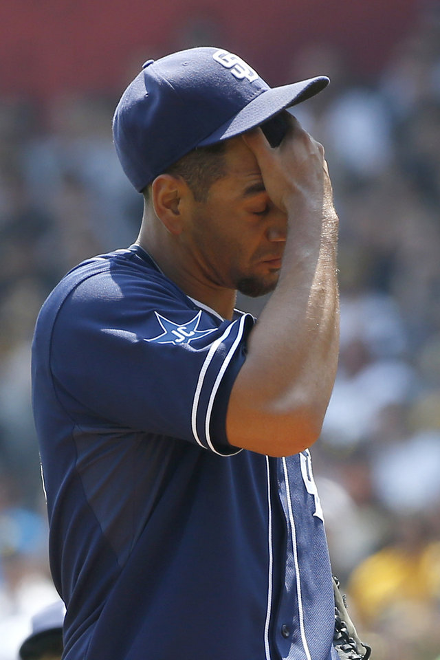 Photo - San Diego Padres starting pitcher Tyson Ross wipes his face after giving up a walk to Pittsburgh Pirates' Ike Davis in the first inning of the baseball game on Sunday, Aug. 10, 2014, in Pittsburgh. (AP Photo/Keith Srakocic)