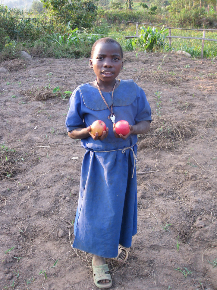 A Rwanda child hold apples from an Apples for Africa orchard in Rwanda. Photo provided <strong></strong>