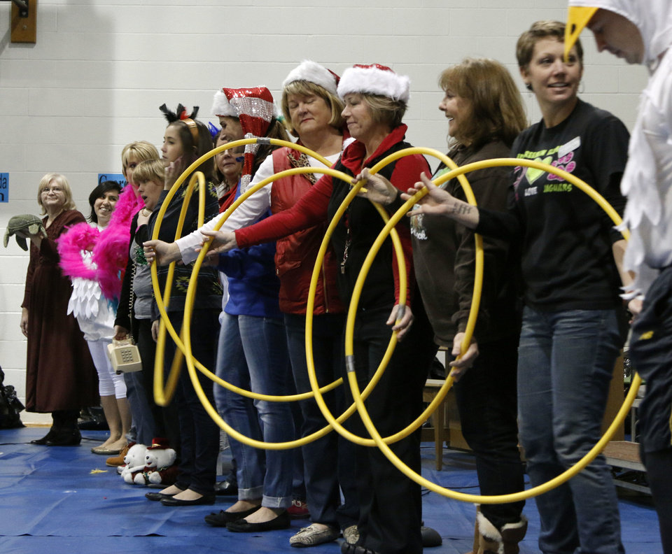 Photo - Teachers at Ida Freeman Elementary School perform the