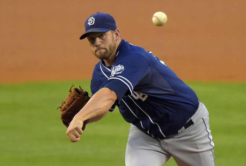 Photo - San Diego Padres starting pitcher Eric Stults throws to the plate during the first inning of a baseball game against the Los Angeles Dodgers, Wednesday, Aug. 20, 2014, in Los Angeles.  (AP Photo/Mark J. Terrill)
