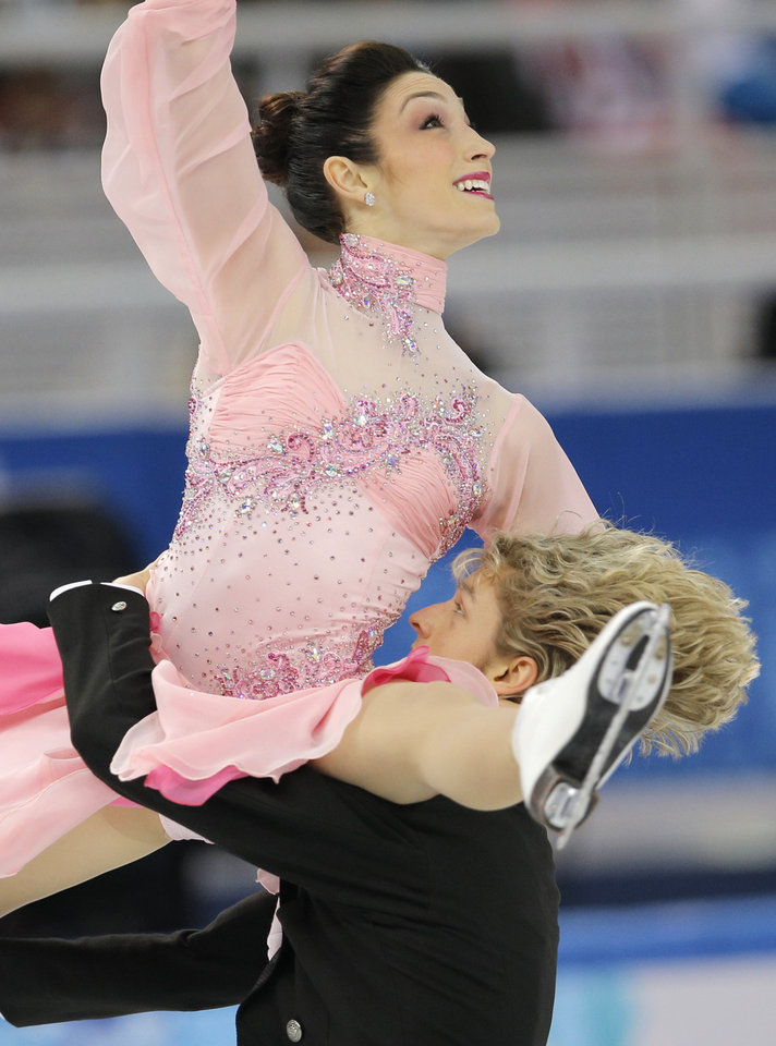 Photo - Meryl Davis and Charlie White of the United States compete in the team ice dance short dance figure skating competition at the Iceberg Skating Palace during the 2014 Winter Olympics, Saturday, Feb. 8, 2014, in Sochi, Russia. (AP Photo/Vadim Ghirda)