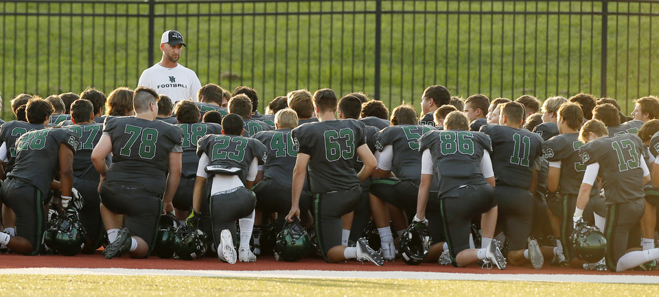 Photo -  Norman North has a meeting during a high school football scrimmage at Moore Schools Stadium in Moore, Okla., Thursday, Aug. 20, 2015. Photo by Nate Billings, The Oklahoman