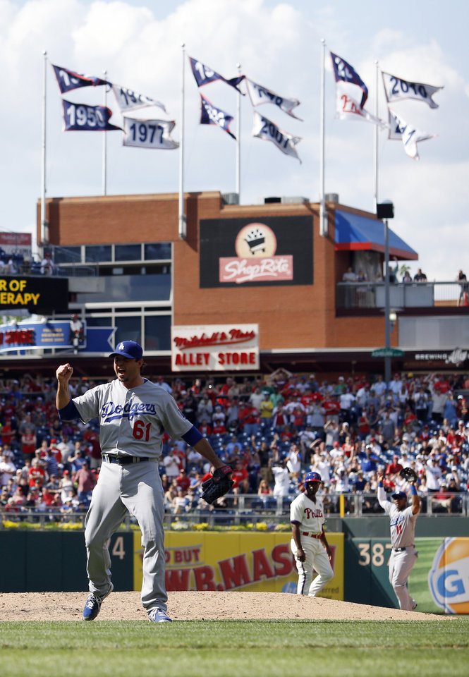 Photo - Los Angeles Dodgers starting pitcher Josh Beckett reacts after striking out Philadelphia Phillies' Chase Utley looking for a no-hitter baseball game, Sunday, May 25, 2014, in Philadelphia. Los Angeles won 6-0. (AP Photo/Matt Slocum)