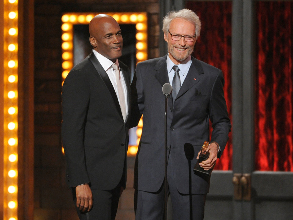 Photo - Clint Eastwood, right, presents the award for best direction in a play to Kenny Leon for