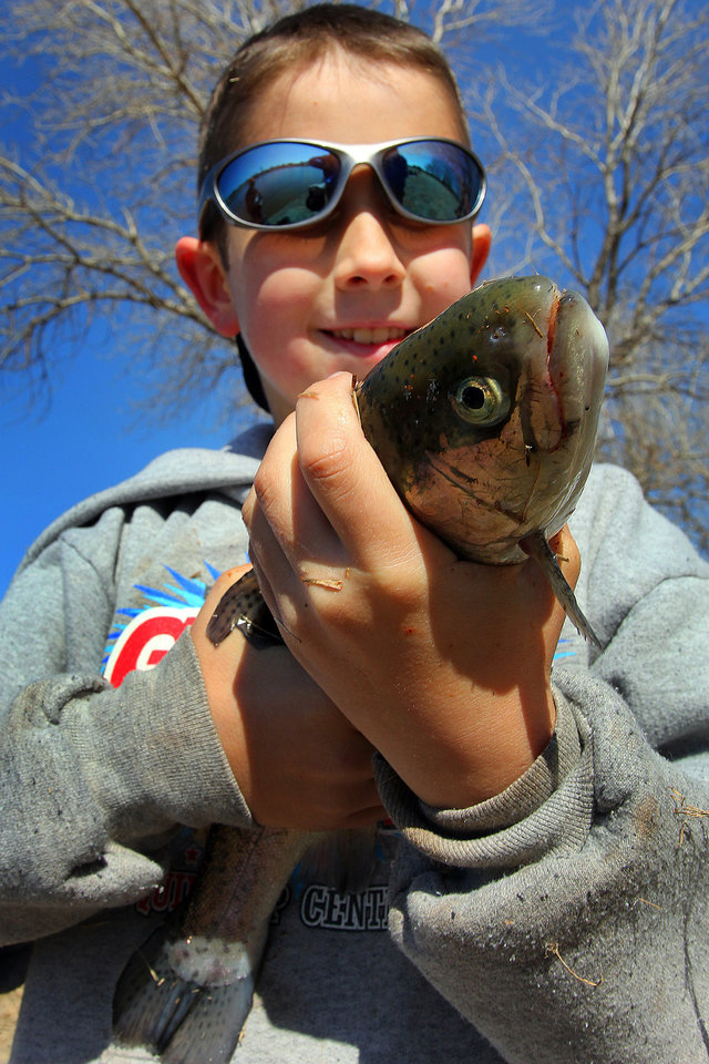 Hunter Ogden, 10, of Yukon shows off his first catch of the day during the Trout Fish Out Saturday, March 2, 2013,  morning at the Dale Robertson Activity Center pond in Yukon. PHOTO BY HUGH SCOTT FOR THE OKLAHOMAN