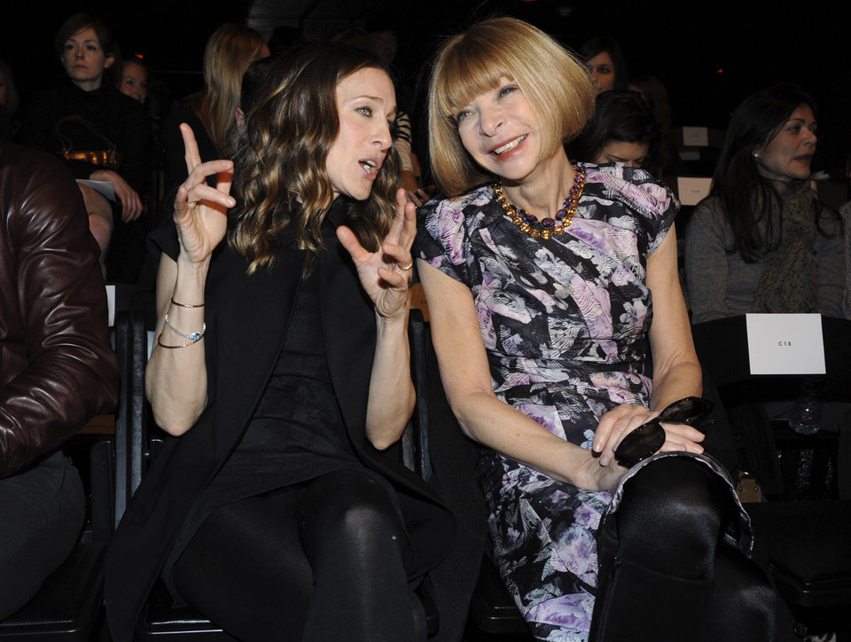 Actress Sarah Jessica Parker, left, and Anna Wintour converse on the runway before the showing of the fall 2009 collection of Alexander Wang during Fashion Week, Saturday, Feb. 14, 2009, in New York. (AP Photo/ Louis Lanzano)