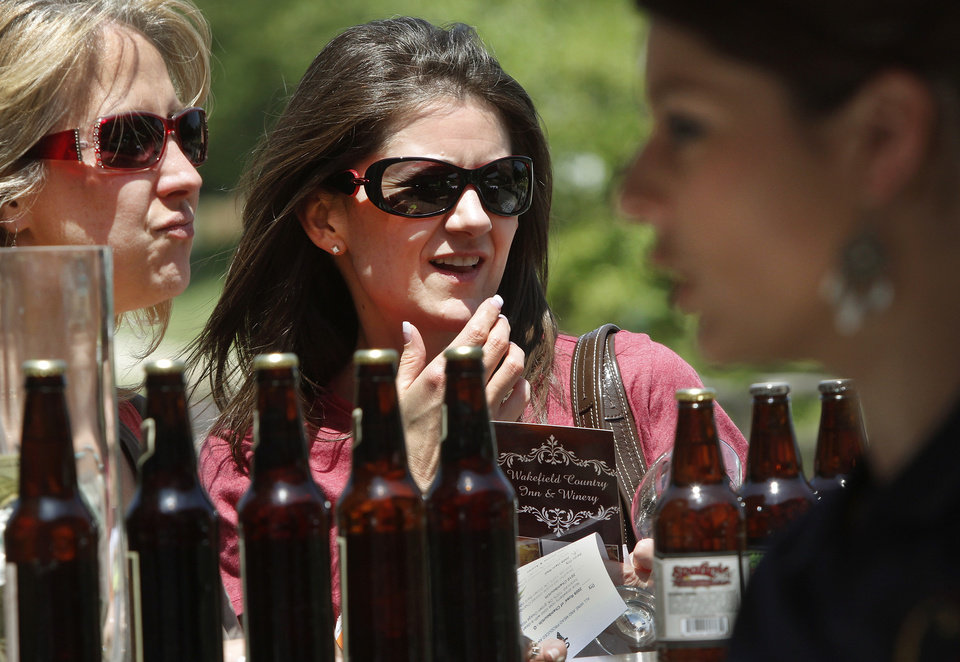 Renee Guthery, left, and Robin Collins, both of Midwest City, discuss choices of locally brewed beers available at the Made in Oklahoma Festival held inside and on the grounds of the Reed Conference Center at the Sheraton Midwest City Hotel Saturday afternoon, May, 19, 2012.  Five Oklahoma breweries and eight Oklahoma wineries had samples for visitors to the festival. Photo by Jim Beckel, The Oklahoman