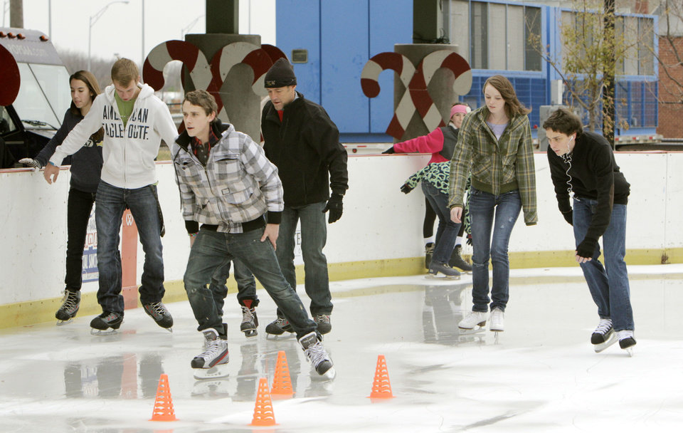 Edmond residents enjoy a new outdoor skating rink at Edmond's Festival Market Place in Edmond, OK, Friday, Nov. 25, 2011. By Paul Hellstern, The Oklahoman