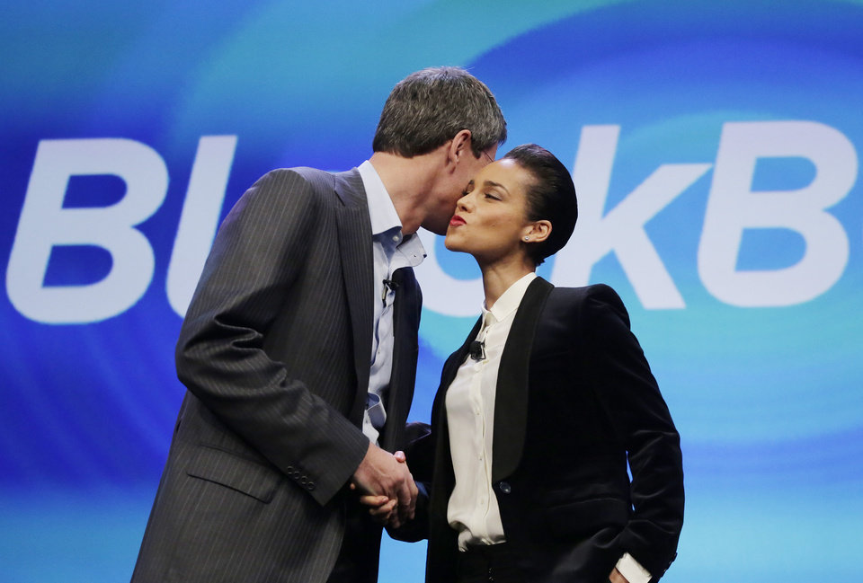 Photo - Thorsten Heins, CEO of Research in Motion, kisses Alicia Keys as he introduces her as the Global Creative director of Blackberry, Wednesday, Jan. 30, 2013 in New York. The maker of the BlackBerry smartphone is promising a speedy browser, a superb typing experience and the ability to keep work and personal identities separate on the same phone, the fruit of a crucial, long-overdue makeover for the Canadian company. (AP Photo/Mark Lennihan)