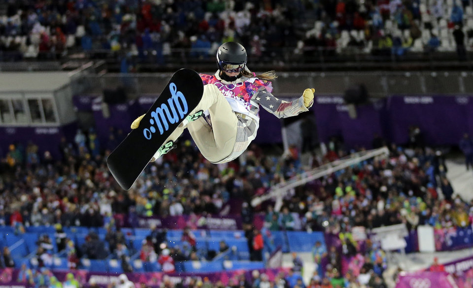 Photo - United States' Kaitlyn Farrington competes to win the gold medal in the women's snowboard halfpipe at the Rosa Khutor Extreme Park, at the 2014 Winter Olympics, Wednesday, Feb. 12, 2014, in Krasnaya Polyana, Russia. (AP Photo/Andy Wong)