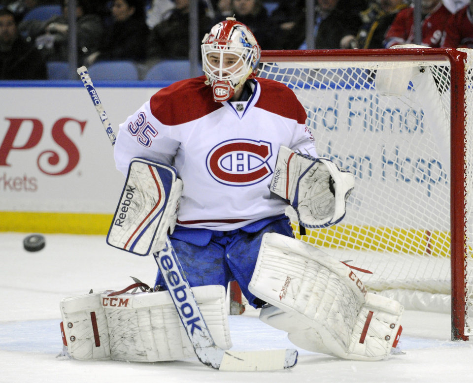 Photo - Montreal Canadiens goaltender Dustin Tokarski makes a save during the first period of an NHL hockey game against the Buffalo Sabres in Buffalo, N.Y., Sunday, March 16, 2014. (AP Photo/Gary Wiepert)