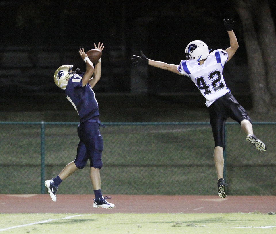 Photo - HH Chedon catches a pass from Sterling Shepard with Caleb Bergquist covering that he took into the end zone for a TD during the high school football game between Heritage Hall and NOAH in Oklahoma City, Friday, Oct. 1, 2010. Photo by Doug Hoke, The Oklahoman.
