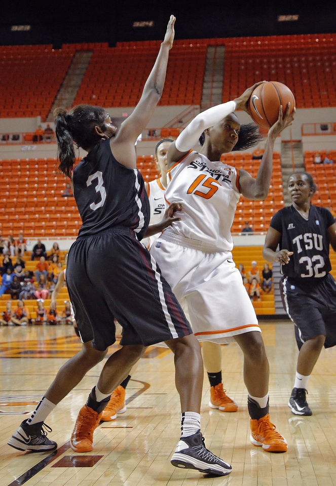 Oklahoma State 's Toni Young (15) tries to get past Texas Southern 's Gianne Fleming (3) during the women's college basketball game between Oklahoma State University and Texas Southern University on Saturday, Dec. 1, 2012, in Stillwater, Okla.   Photo by Chris Landsberger, The Oklahoman