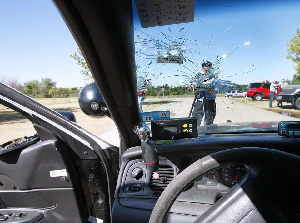 Damage can be seen on the police car of Oklahoma City police officer Katie Lawson, who survived being shot by an AR-15 rifle in August 2010.  Photo by Paul Hellstern, The Oklahoman