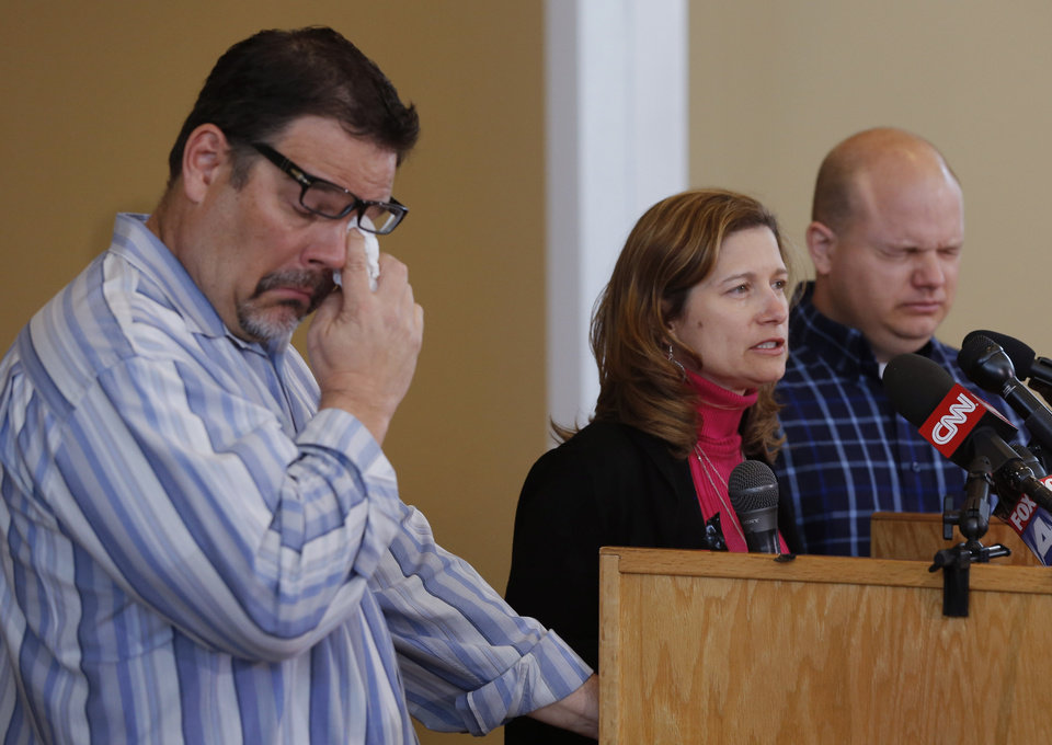 Photo -  Above: Will Corporon, left, and Tony Corporon, right, fight emotions Monday while Mindy Losen, center, talks about her son and father during a news conference at their church in Leawood, Kan. AP PHOTO    Orlin Wagner -  AP