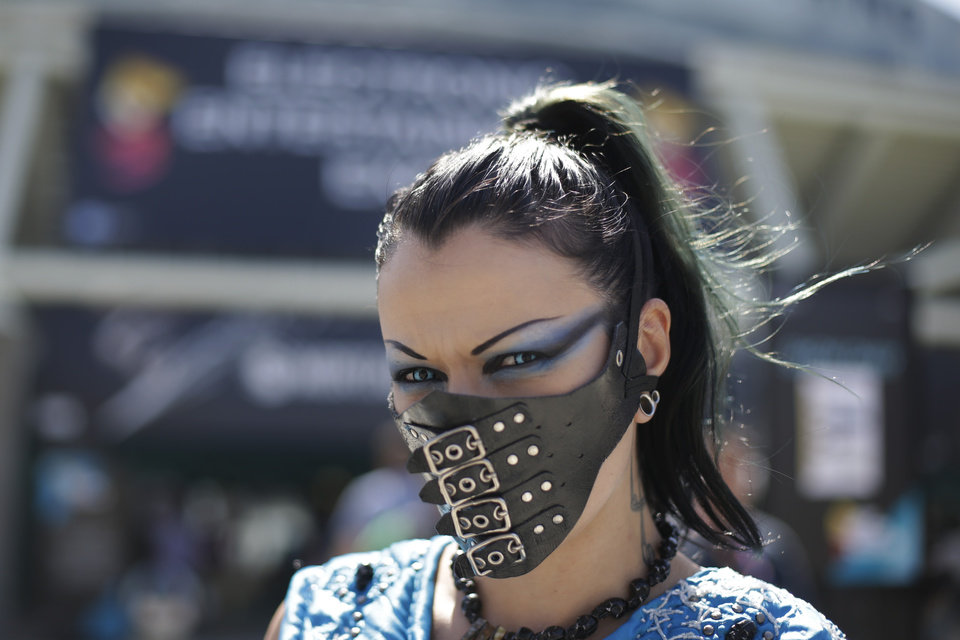 Photo - A woman who goes by Sin Fisted pauses for photos at the Electronic Entertainment Expo on Wednesday, June 11, 2014, in Los Angeles. (AP Photo/Jae C. Hong)