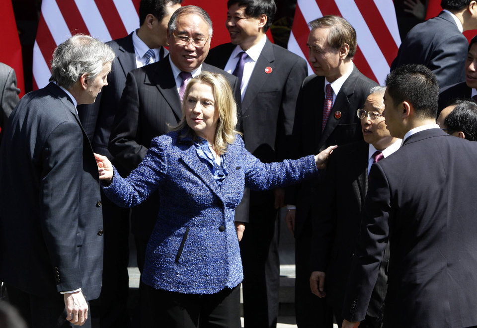 Photo -   U.S. Secretary of State Hillary Rodham Clinton, second from left, introduces an official to Chinese State Councilor Dai Bingguo, second from right, as they attend a group photo session after the opening ceremony of U.S.-China Strategic and Economic Dialogue at the Diaoyutai state guesthouse in Beijing, Thursday, May 3, 2012. (AP Photo/Jason Lee, Pool)