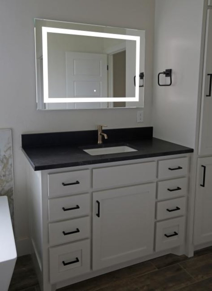 Photo -  Features in the Festival of Homes show home include this lighted vanity mirror. [BRYAN TERRY/THE OKLAHOMAN]