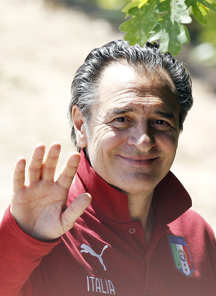 Photo - Italy coach Cesare Prandelli waves to journalists during a training session in Coverciano training complex, in Florence, Italy, Wednesday, May 21, 2014. The Azzurri will train for three days this week then resume full-time preparation next Monday. In Brazil, Italy is in Group D with England, Uruguay and Costa Rica. (AP Photo/Fabrizio Giovannozzi)