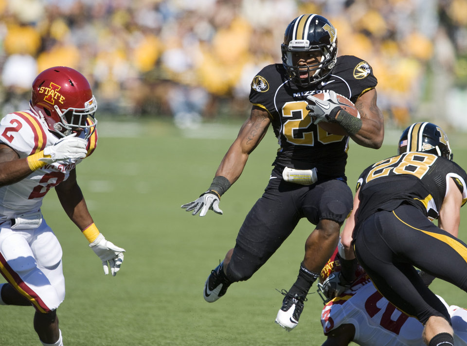 Missouri running back Henry Josey, center, leaps in the air as he tries to get past Iowa State's Jansen Watson, left, during the first half of an NCAA college football game Saturday, Oct. 15, 2011, in Columbia, Mo. (AP Photo/L.G. Patterson) ORG XMIT: MOLG102