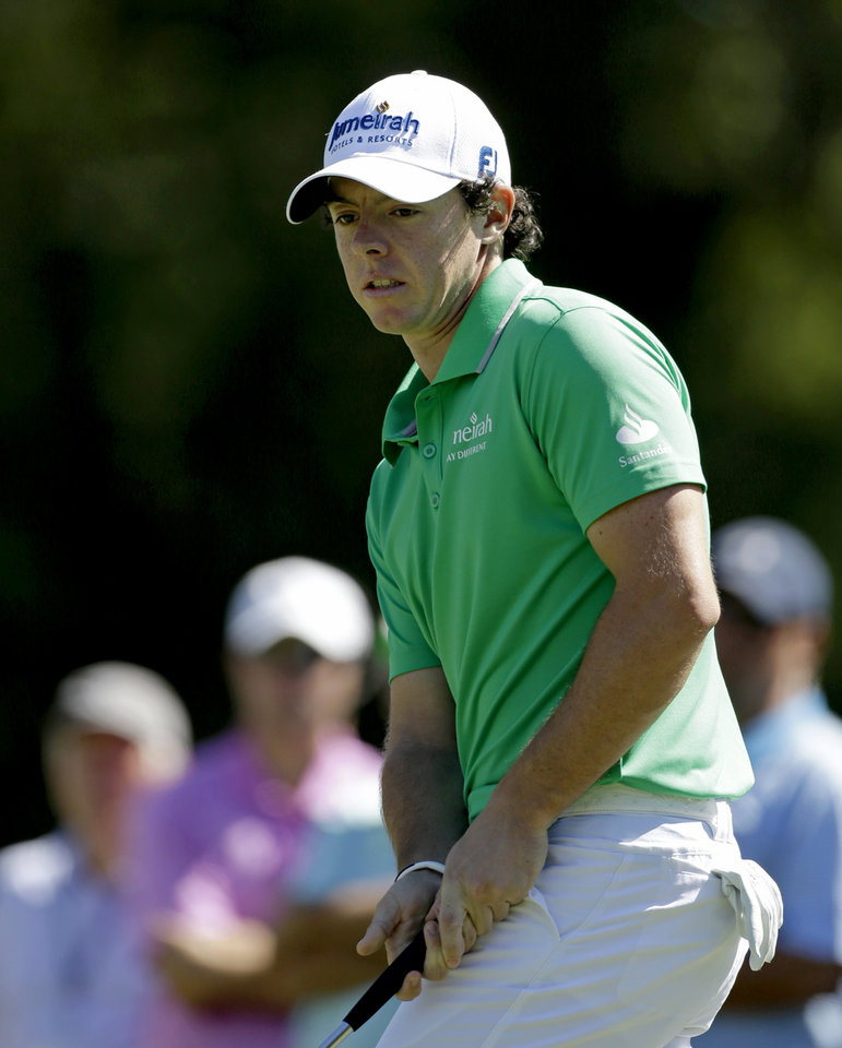 Photo -   Rory McIlroy, of Northern Ireland, watches his putt on the fourth hole during the final round of the Tour Championship golf tournament on Sunday, Sept. 23, 2012, in Atlanta. (AP Photo/David Goldman)