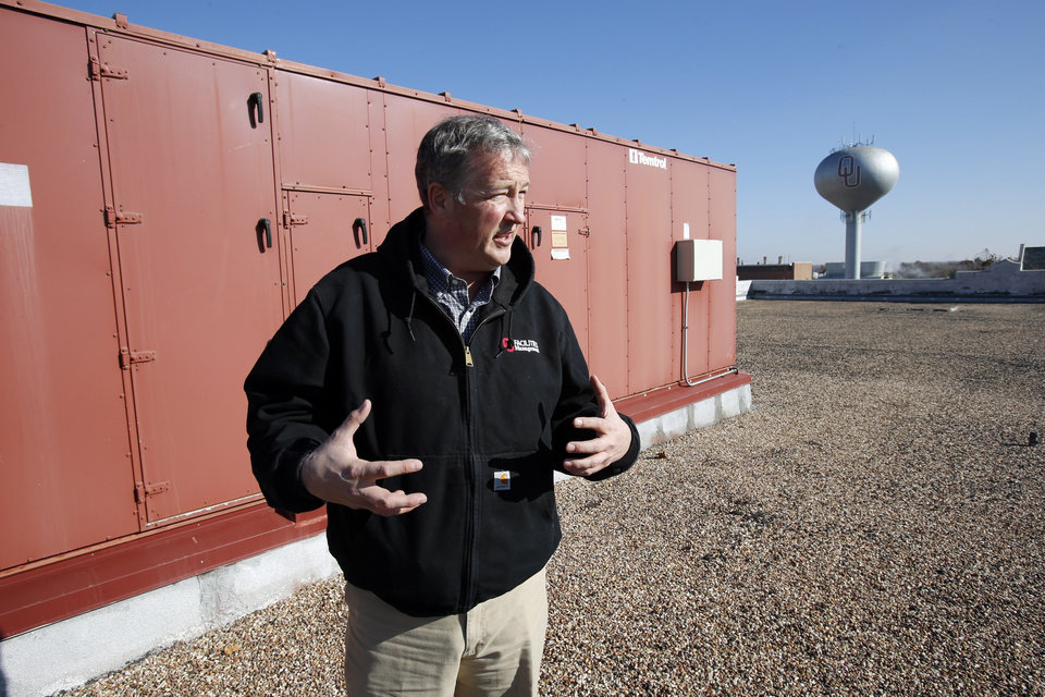 University of Oklahoma facilities manager Brian Ellis stands next to a new roof-top air conditioning unit as he shows energy saving enhancements to the Norman campus on Tuesday, Nov. 27, 2012 in Norman, Okla.  Photo by Steve Sisney