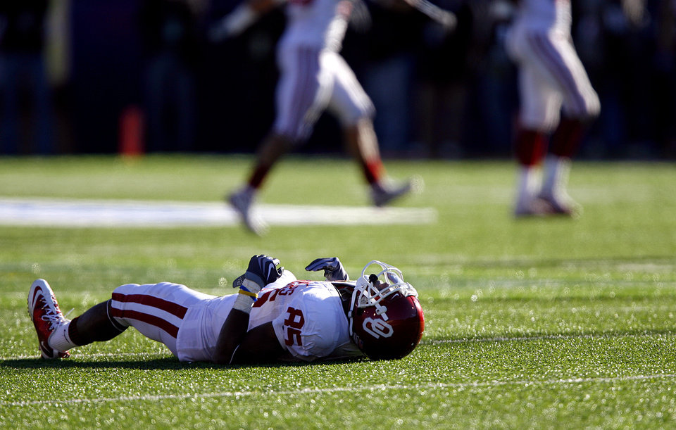 Photo - Oklahoma's Ryan Broyles (85) lays on the field after being leveled by a hit on a punt return catch during the second half of the Brut Sun Bowl college football game between the University of Oklahoma Sooners (OU) and the Stanford University Cardinal on Thursday, Dec. 31, 2009, in El Paso, Tex.   Photo by Chris Landsberger, The Oklahoman