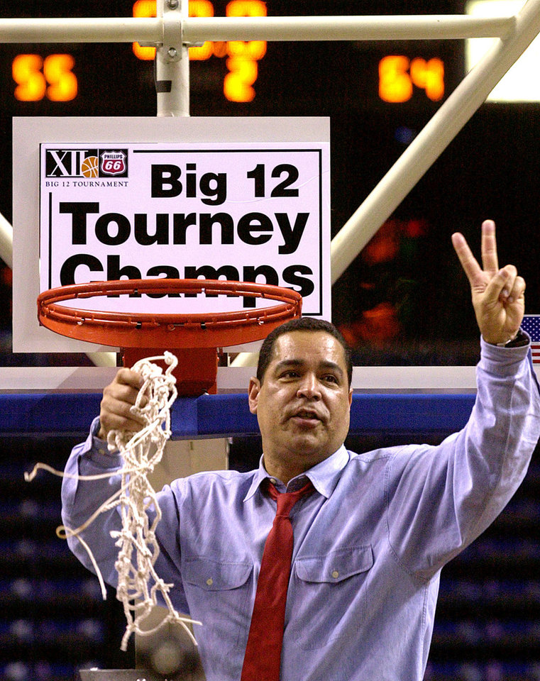 University of Oklahoma Men's college basketball against Kansas  during championship of the Men's Big 12 tournament in Kemper Arena, Kansas City, Missouri, Sun., March10, 2002.  OU coach Kelvin Sampson holds two fingers up to celebrate his team's second straight Big 12 tournament championship after they beat Kansas 64 to 55.  Staff photo by Bryan Terry