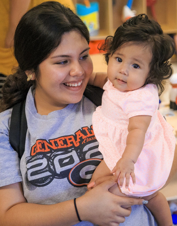 Photo -  High School student Brianna Rodriguez holds her baby, Armani Lopez, on Thursday in the new childcare center at U.S. Grant High School. [Photo by Chris Landsberger, The Oklahoman]