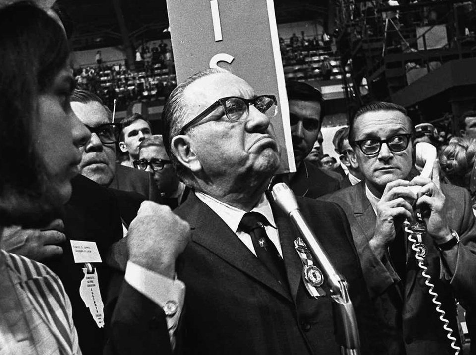 Photo -   FILE - In this Aug. 28, 1968 file photo, Mayor Richard J. Daley pumps his fist as he speaks from the floor of the Democratic National Convention in Chicago. In the years since 1968, a second Mayor Daley has come and gone. Former Mayor Richard M. Daley, who took over the city 10 years after his father died and then retired last year after 22 years in office, is largely credited for helping to lead the city's transformation from a gritty industrial center to a booming hub of international commerce. The city will have the international spotlight when it hosts the NATO summit May 20-21, 2012 and give the city and Mayor Rahm Emanuel a chance to hone its image. (AP Photo/File)