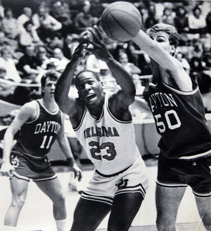 Photo - Former OU basketball player Wayman Tisdale. Wayman Tisdale battles Jeff Zern of Dayton for a loose ball in Saturday's 89-85 NCAA Tournament loss to the Flyers. 3-18-84 ORG XMIT: KOD