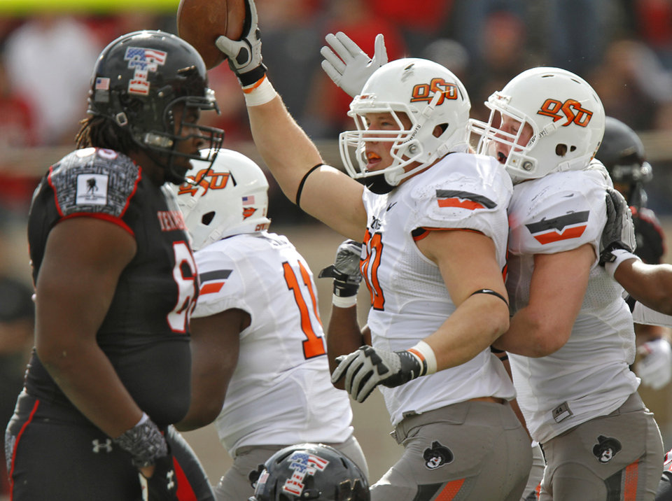 Photo - Oklahoma State Cowboys defensive end Cooper Bassett (80) reacts after an interception during the college football game between the Oklahoma State University Cowboys (OSU) and Texas Tech University Red Raiders (TTU) at Jones AT&T Stadium on Satruday, Nov. 12, 2011. in Lubbock, Texas.  Photo by Chris Landsberger, The Oklahoman  ORG XMIT: KOD
