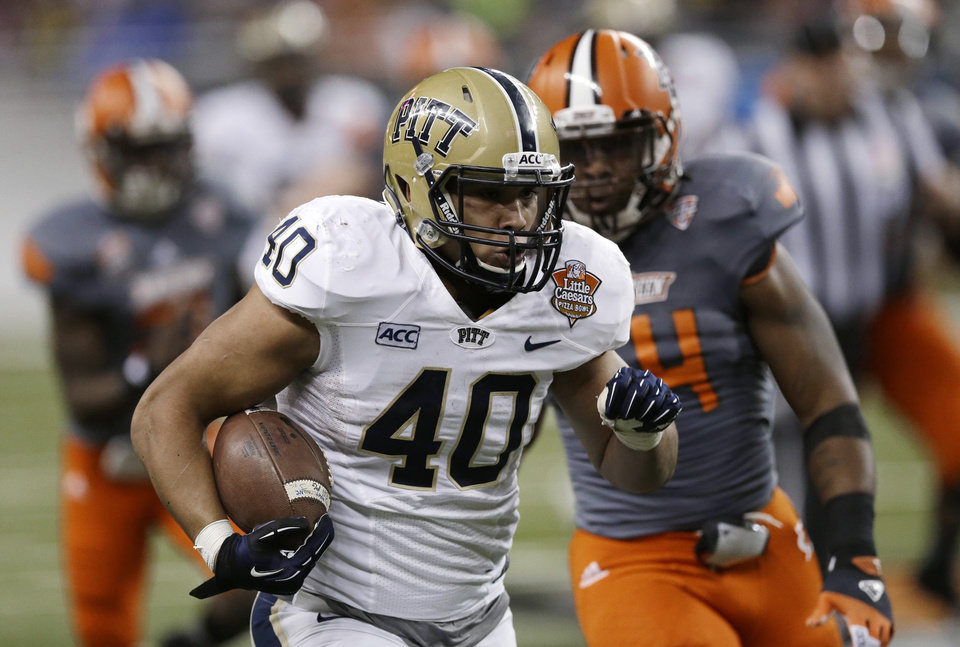 Pittsburgh running back James Conner (40) rushes during the second half of the Little Caesars Pizza Bowl NCAA college football game against Bowling Green, Thursday, Dec. 26, 2013, in Detroit. (AP Photo/Carlos Osorio)